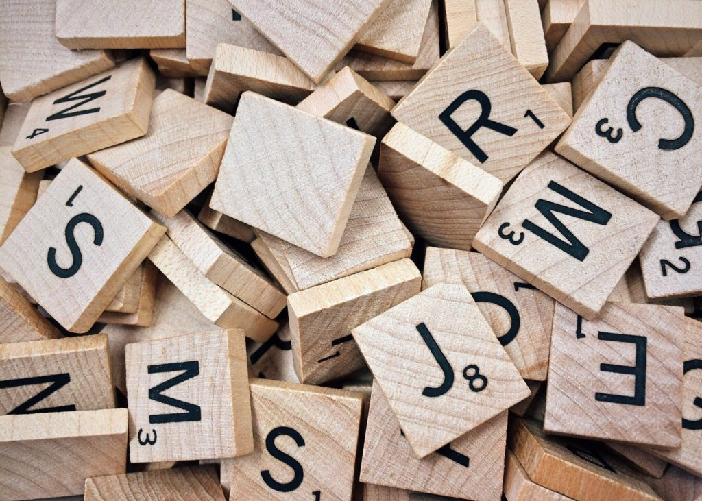 11+ Tips Verbal Reasoning. Wooden scrabble letters
