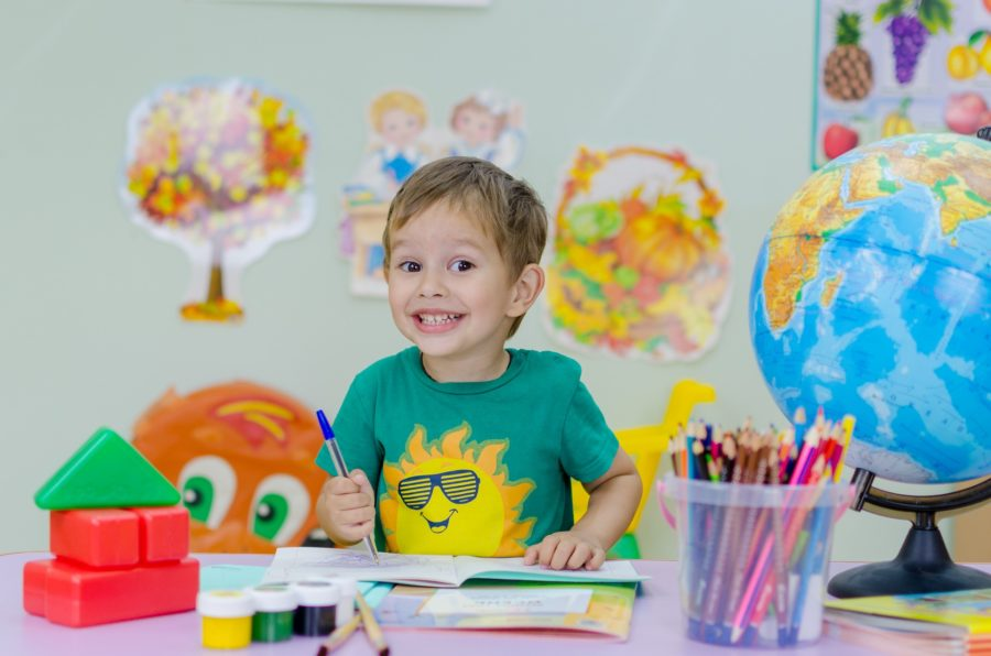 London Montessori Schools. Boy at colourful table.