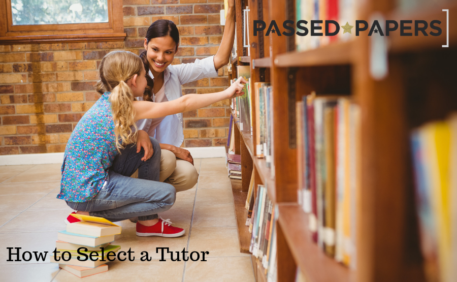 How to select a tutor. Woman and girl choosing books at large book shelf.