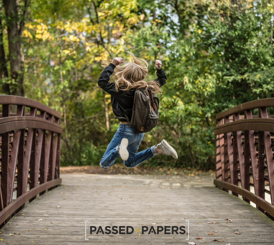 Set your child for career success. Girl on wooden bridge. Jumping for joy.