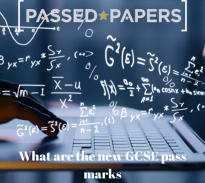 What are the new GCSE pass marks? Hands using laptop with mathematical formulas.