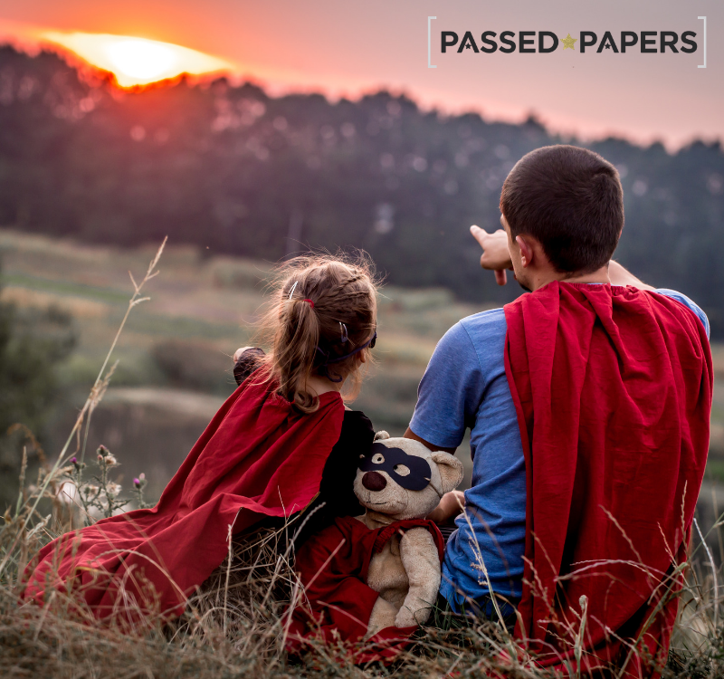 Super Tutor. Man and girl with capes on watching the sunset