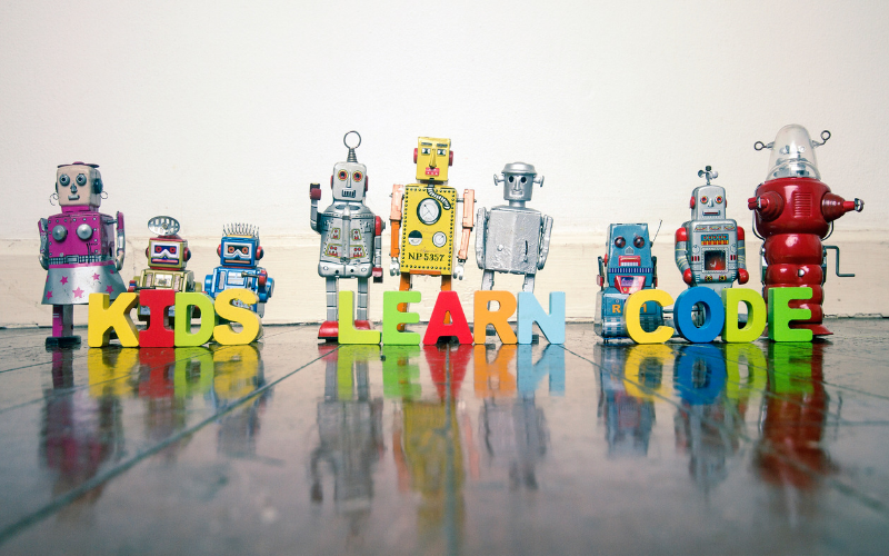 Kids coding camps. Colourful robots with words kids learn code