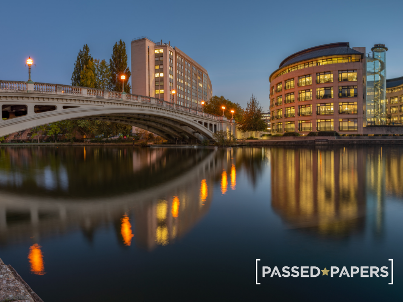 Slough 11 plus practice. Night time with water, bridge and buildings