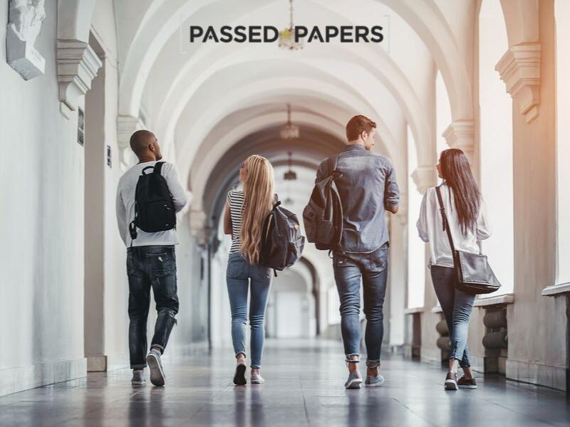 University students walking through hallway.