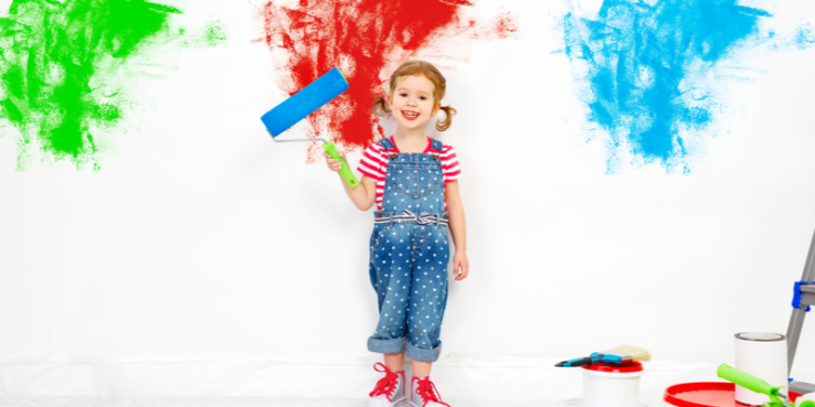 How stressed is your child. Child with paint roller and different colours.