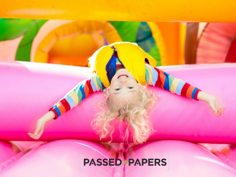 Relaxed girl on colourful bouncy castle