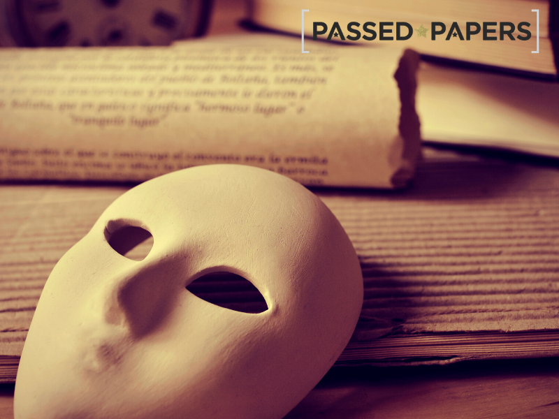 Mask and old papers representing playwriting learning