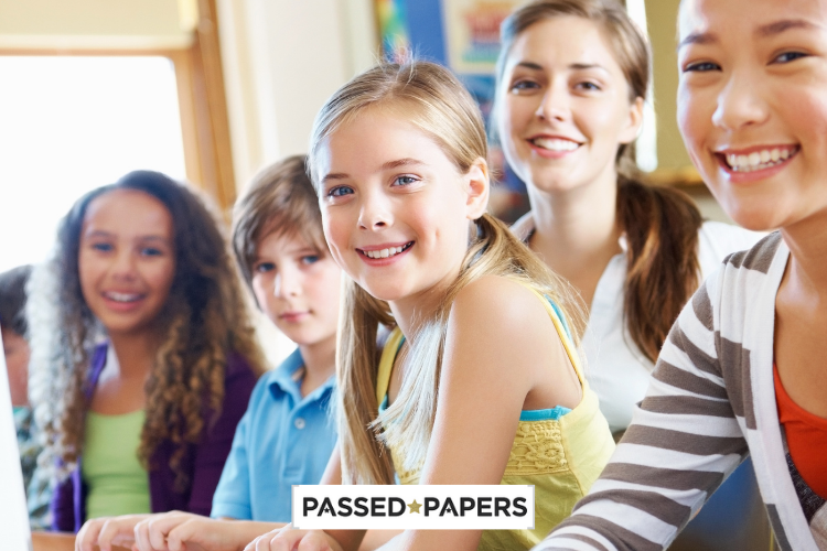Smiling children in class for Keystage 2 papers