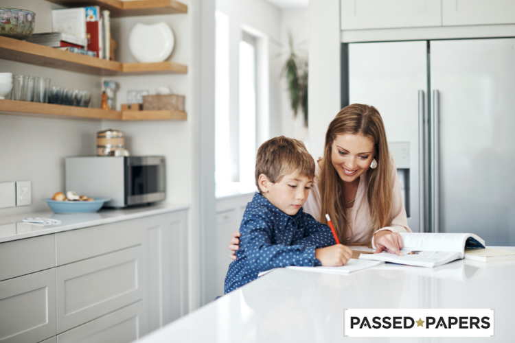 Mom helping boy at kitchen with MAP practice test guide for parents
